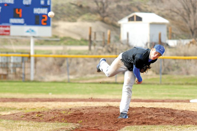 Ben Williams, a Hayden High School senior who plays for Moffat County High School, throws a pitch against Battle Mountain High School on Tuesday at Craig Middle School. Williams and fellow Tigers Graig Medvesk and Mark Doolin drive to Craig each weekday to play with the Bulldogs varsity team.