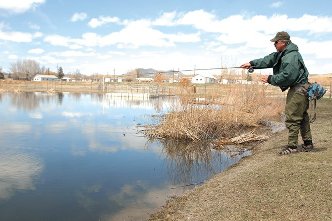 Dave Pike, Craig Parks and Recreation director, fly fishes Monday at the pond behind the Moffat County Public Safety Center. Pike, who has been fly fishing for more than 20 years, will soon host a two-day introductory course for anyone interested.