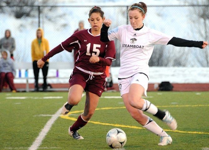 Steamboat Springs High School girls soccer player Meghan Rabbitt stays a step ahead during a race for a loose ball Friday as the Sailors beat Palisade, 3-2.