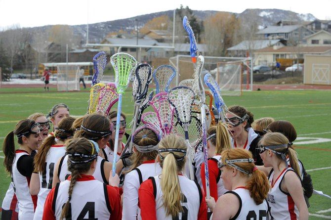 Steamboat Springs High School girls lacrosse players prepare to take the field during Tuesday's game against Battle Mountain. The Sailor have had a turbulent past but are showing positive signs of improvement.