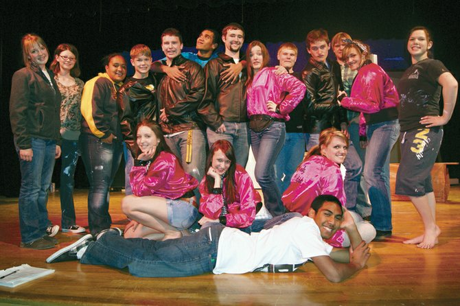 "Members of the Meeker High School Drama Club gather for a group shot during rehearsals for the upcoming spring musical, ""Grease."" The show is directed by Gary Zellers, who has previously helmed productions of ""Guys and Dolls"" and ""Little Shop of Horrors"" for the troupe. He also directed ""Grease"" with a different cast in 2006. The curtain rises for the show at 7 p.m. April 22 and 23 at Meeker High School, 550 School St., in Meeker."