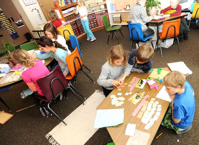 Students in Karen Kutska's lower Montessori class work through various projects Thursday at Strawberry Park Elementary School in Steamboat Springs.