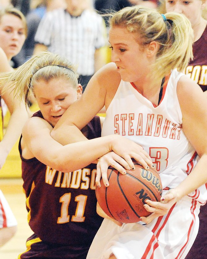 Steamboats Eryn Rinck fights for the ball in a game last season against Windsor. Rinck and nine other players have been traveling to Denver on Sundays to play games against Front Range teams.