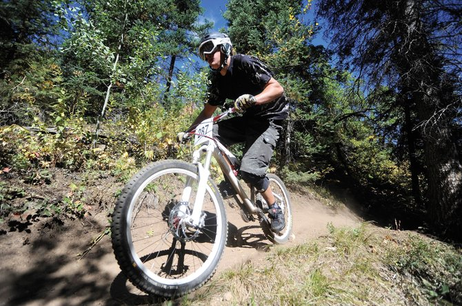 Greg Jansen rides down Creekside Trail during the Sept. 18 downhill race. Steamboat Ski Area and the U.S. Forest Service are working on new trail plans to be implemented starting this summer.