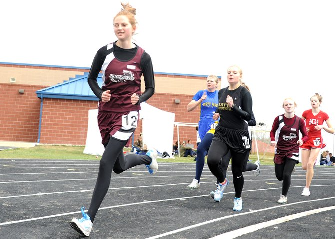 Soroco's Josie Rossi leads a pack of runners Saturday in the 800-meter run at a track meet in Rifle. Hayden and Soroco high school fielded teams in the event, earning many top finishes.