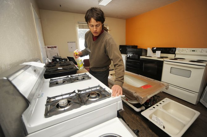 Habitat ReStore manager Martin Krueger cleans appliances at the outlet store at 718 Oak St. in Old Town Steamboat Springs. The Routt County Habitat for Humanity store sells used appliances at discounted prices.