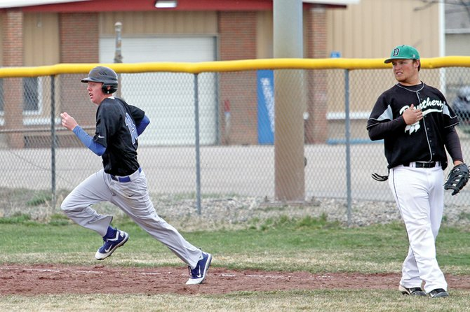 Wyatt Oberwitte, left, rounds first base April 16 against Delta High School at Craig Middle School. The Moffat County High School varsity baseball team will make a final push for the playoffs with three Western Slope League doubleheaders in the next two weeks.
