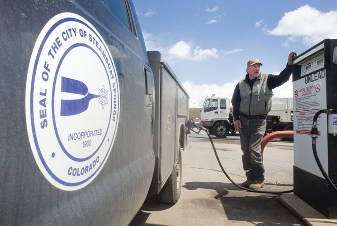 Joe Pokay, city fleet manager for the city of Steamboat Springs, fuels up a city truck Tuesday afternoon at a city maintenance facility. Pokay said that the city buys gas in bulk but that higher prices could create greater fuel costs than expected for the city this year.