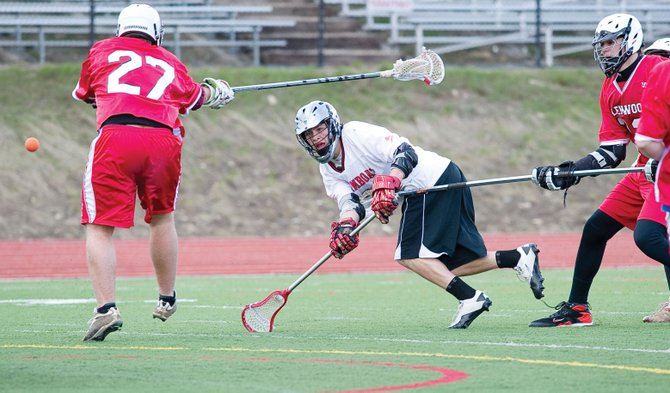 Steamboat Springs High School sophomore Christian Ramirez shoots and scores in the second half of Wednesday night's lacrosse game against Glenwood Springs at Gardner Field. The Sailors won, 16-0, for their 29th straight conference win.
