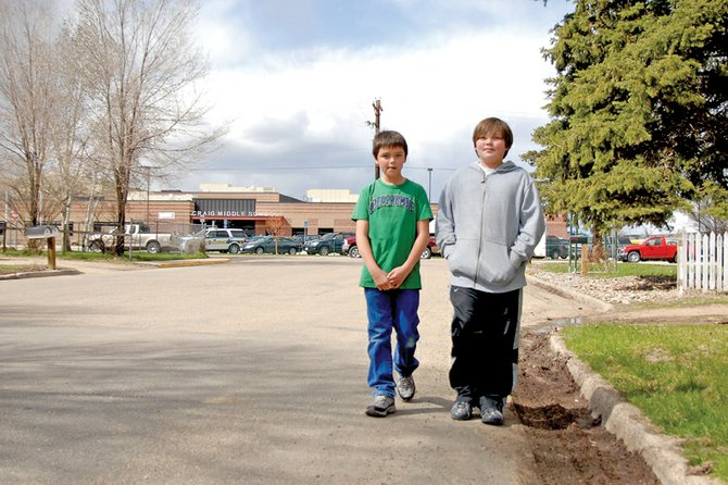 Skylar Dean, left, and Codie Shelley walk home Wednesday from Craig Middle School down Russell Street. Shelley, a sixth grader at CMS, said he walks Russell Street every day after school. Russell Street is one of several streets in the school's vicinity expected to get a sidewalk as part of a city project being funded by a grant through the Colorado Department of Transportation.