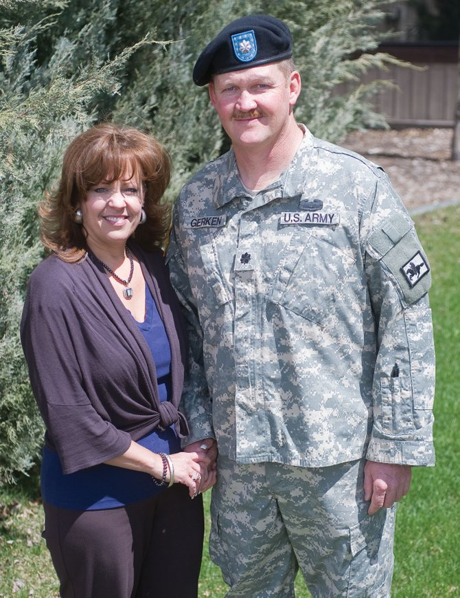 Lt. Col. Frank Gerken, joined by his wife, Mary, is retiring after 31 years in the Army National Guard.