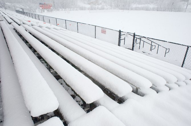 The bleachers at Gardner Field have been covered with snow a lot this spring, and Friday was no exception. The weather has wreaked havoc on spring sports this year, creating a busy schedule for teams before the season ends.