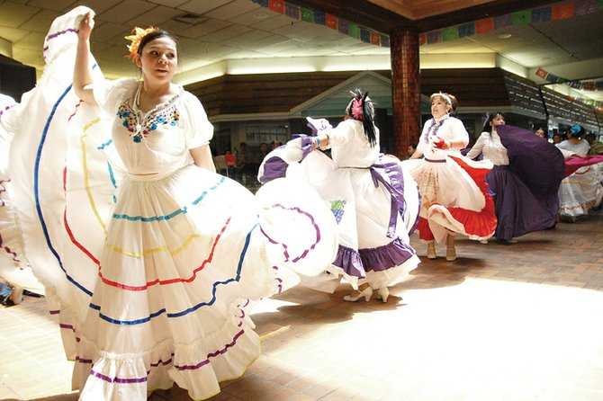 Yesinia Nunez, left, performs a traditional Mexican dance alongside other members of the Rifle Folkloric Dance Group on Saturday during the Cinco de Mayo celebration at Centennial Mall in Craig. The event also featured a Mexican band, 16 vendors and a bounce room for children.