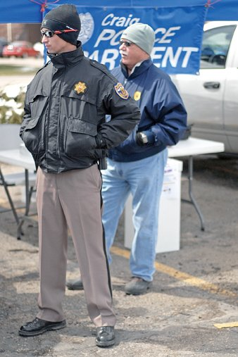 Colorado State Patrol trooper Matt Normandin, left, and Craig Police Department Sgt. John Forgay stand next to a deposit box Saturday during National Prescription Drug Take Back Day at the Centennial Mall parking lot. The two agencies hosted the event in which unused, unwanted or expired prescription drugs could be discarded.