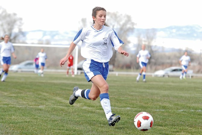 Kelly Ciesco, a Moffat County High School junior, kicks the ball toward the Grand Junction Central High School net Monday at Loudy-Simpson Park. Ciesco scored the first goal for the MCHS girls varsity soccer team, and the Bulldogs never let up, beating the Warriors 5-1.
