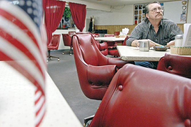 Don Offutt, a U.S. Navy veteran of the Vietnam War, relaxes after breakfast Tuesday at the Veterans of Foreign Wars Post 4265 in Craig. This week, several area veterans reacted to the death of Osama bin Laden, who was killed Sunday in Pakistan by a U.S. Navy SEAL unit.