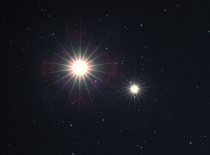 When the two brightest planets pass each other in the night, the result can be spectacular. Seen here during their close conjunction Nov. 4, 2004, Venus (the brighter planet) and Jupiter flare brightly in the lens of the camera, creating their striking rayed appearance. The close conjunction of these same two planets on the morning of May 11 won't be seen in a totally darkened sky, but should be breathtaking nonetheless.