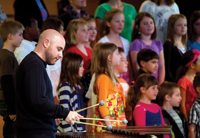 Musician Simon Boyar plays a marimba along with the Christian Heritage School choir Wednesday afternoon at Strings Music Pavilion. The summer program wraps up with shows at 7 p.m. today and Friday.