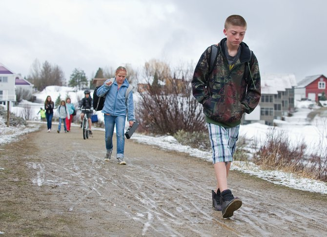 Seventh grader Will Scully and other students walk to school along the trail in Butcherknife Canyon Wednesday morning during Wednesday's Hike and Bike to School program. The program is an effort to get children to walk, or ride their bikes to school instead of getting a ride from their parents or riding the bus.