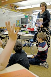 Sandrock Elementary School teacher Michele Conroy addresses her second-grade students during a reading session Tuesday. Conroy is this year's winner of the Colorado Education Association's highest honor — the CEA Award.