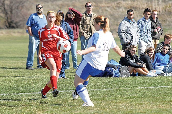 Steamboat Springs High School's Cassidy Fox faces off against a Moffat County High School opponent Wednesday in Craig. The Sailors won, 2-0.