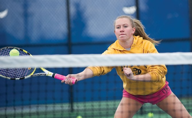 Doubles player Alli Lowrie returns a shot at the net during practice Tuesday afternoon at the Tennis Center at Steamboat Springs. Lowrie, who plays No. 3 doubles with Rachel Grubbs, and the rest of the Sailors will begin play Thursday in Grand Junction.