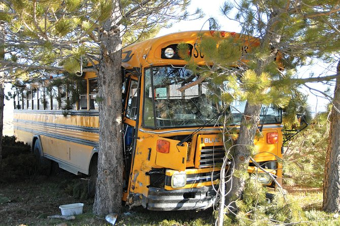 A school bus crash Thursday morning sent four people, including three students, to The Memorial Hospital. The bus went off the road and crashed into trees in the front yard of a house at 1679 County Road 35. State Patrol reported there were no serious injuries in the accident.