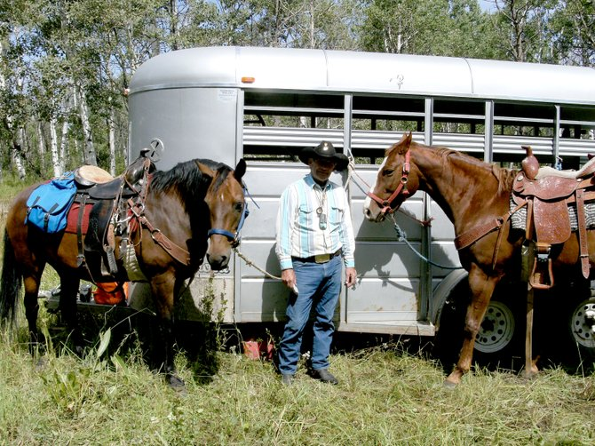 John Nash, who runs the Combat Veterans Cowboy Up equine therapy program, stands with therapy horses, including Bo, left. Bo was last seen during an October hunting trip.