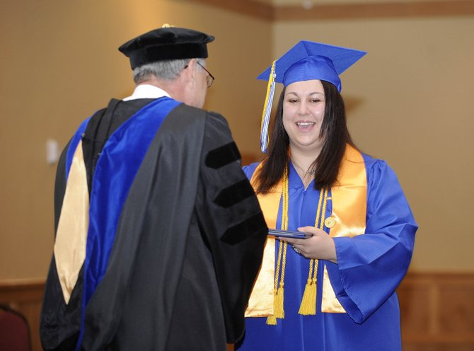 Melissa Antonacci accepts her diploma during Saturday's Colorado Mountain College's Alpine Campus graduation at The Steamboat Grand. Antonacci said she is the first member of her family to graduate from college.