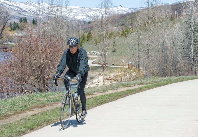 Matthew Crawford rides his bike on the Yampa River Core Trail on Thursday. The city's pending application for an $11 million state grant, through the Regional Tourism Act, is sparking conversations about how Steamboat Springs could upgrade its cycling infrastructure and amenities to spur tourism.
