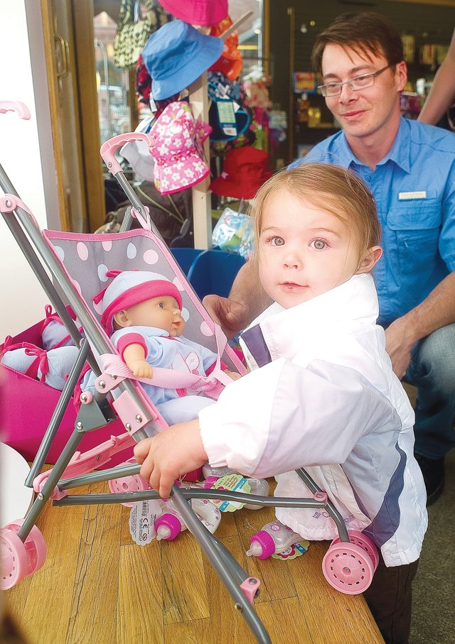 Jason Thompson, of Avon, seemed comfortable in his role as a father while keeping an eye on his 22-month-old daughter, Vega, at the Kookaburra Kidz store Monday afternoon in downtown Steamboat Springs. A free, seven-week program for fathers starts today, offered by the Fatherhood Program of Routt County.