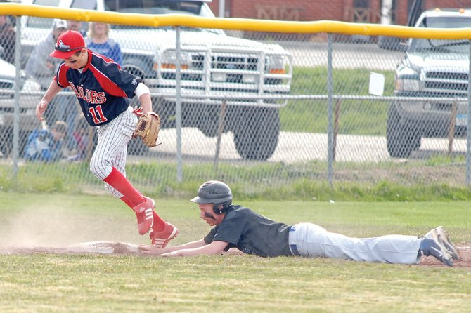 Bubba Ivers, a Moffat County High School sophomore, slides into third base May 3 at Craig Middle School. The MCHS baseball team swept Glenwood Springs on Saturday, 14-3 and 9-6, to finish the regular season and secure the third and final Western Slope League playoff spot.