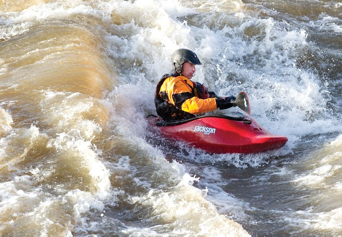 Local kayaker Brian Gardel plays in the whitewater of Charlie's Hole on Tuesday afternoon. Concerns are increasing that fall's repairs to the whitewater feature are not playing out well as river flows increase.