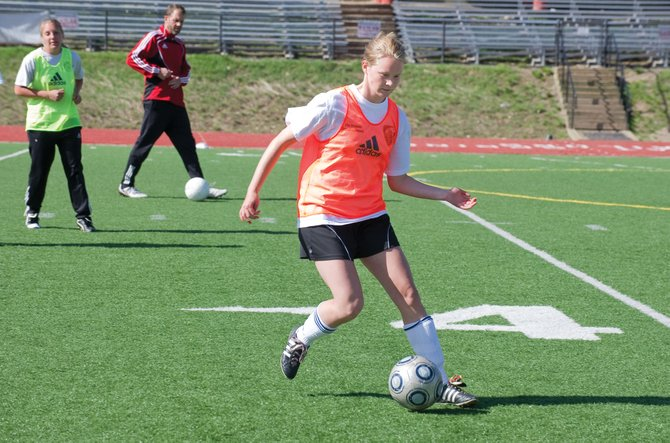 Steamboat Springs soccer player Gracy Whelihan runs through a drill with teammates Tuesday afternoon at Gardner Field. The Steamboat Springs High School girls soccer team will travel to Longmont Wednesday to take on Skyline in the first round of the state playoffs.