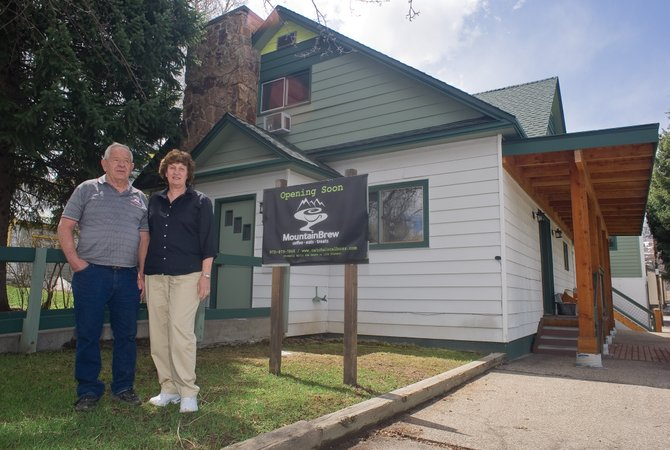 Dewey and Janet Williams stand in front of the building they own at 427 Oak St. The Williams said steep increases in city tap fees could cripple local businesses, while city officials said the new rates went through a lengthy public process and are necessary to ensure city water supplies and infrastructure.