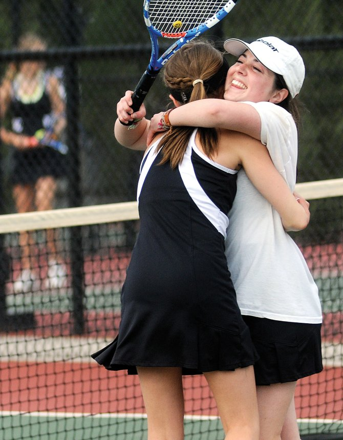 Lauren Siegel, right, and Ali Diehl celebrate a victory at No. 1 doubles as their team rallied from big deficits in a second-round match Thursday at the state tennis tournament in Pueblo. Steamboat qualified three of its seven entries in the state tournament for Friday's Class 4A semifinals. Three other Steamboat entries still can get back in the action via the consolation bracket.