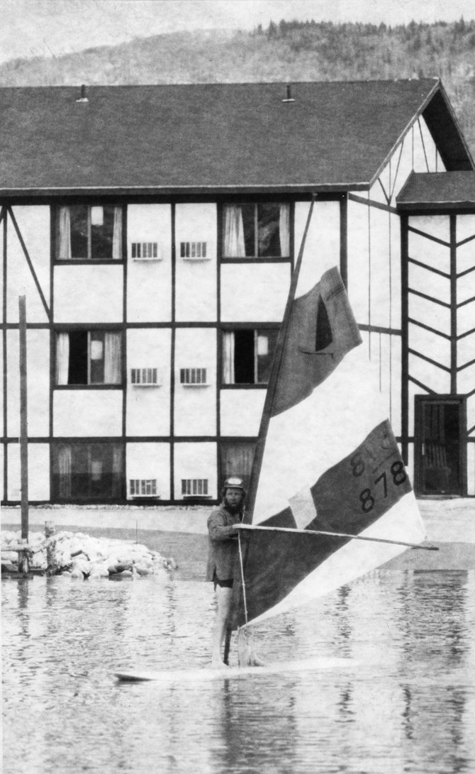 A man identified in newspaper files only as Cap'n Duncan steers his Windsurfer across the parking lot of the former Super 8 Motel in Steamboat Springs on May 24, 1984.