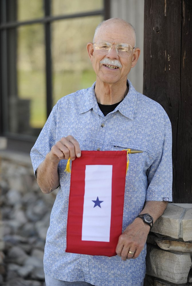In preparation for Memorial Day on May 30, American Legion Post 44 Vice Commander Win Dermody is hand delivering service banners to people who have family members currently serving in the military.