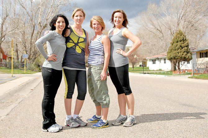 From left, Isis Beckett, Kristin Allen, Kara Schrimsher and Lindsay Anderson stand Thursday afternoon outside of Sunset Elementary School. The four women will host the first run for the Sole Sisters Women's Running Club on Saturday for women interested in running or who simply want to get out of the house. The club will meet at 8:15 a.m. at Sunset Elementary School.