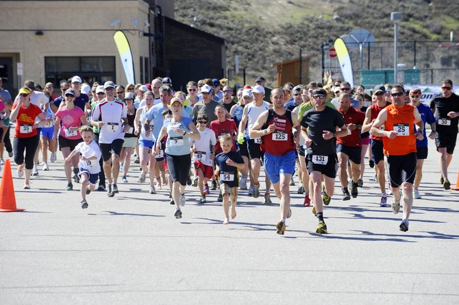 Runners leave the starting line during the Steamboat Springs Running Series' 25th annual Spirit Challenge on Saturday.