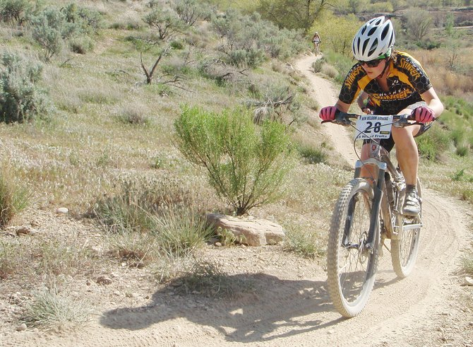 Jo Rolls works her way up a trail last weekend during the 18 Hours of Fruita mountain bike race. Rolls was diagnosed with cancer early in 2010, but she recovered in time to win the Fruita race, with the help of teammate Bec Bale.