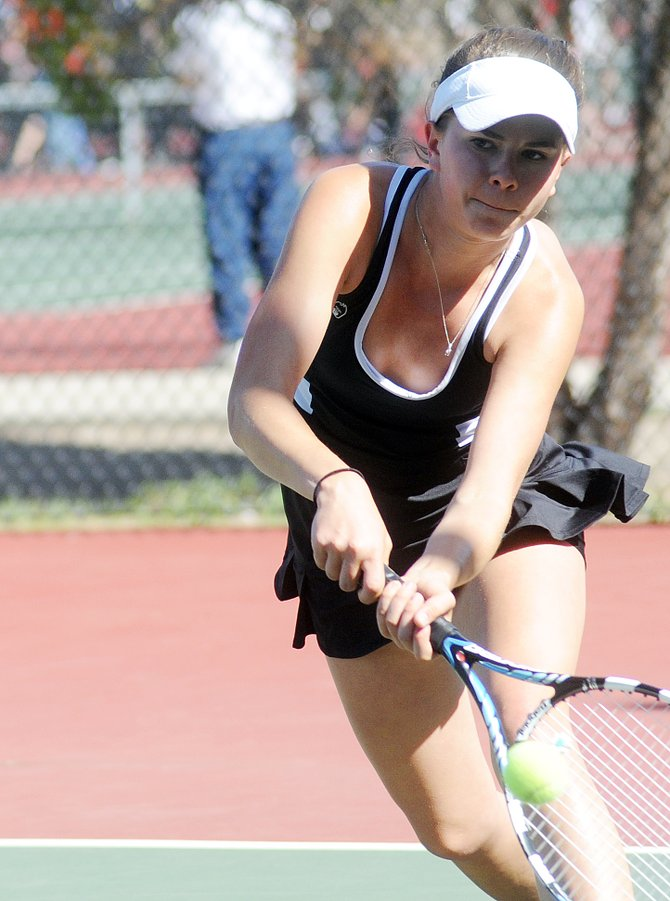 Claire Parsons chases down a return Saturday during the third-place match in the No. 3 singles bracket of the state tennis tournament in Pueblo. Parsons won the match in three sets to close out her senior season with a third-place medal.