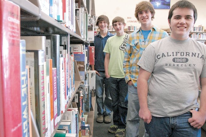 Four members of the Moffat County High School speech and debate team stand Friday in the school library. The students spent the past year researching U.S. troop levels in six foreign countries. After a year of study, the students formed strong opinions on the war in Afghanistan. Pictured, from left, are Matt Balderston, Ben East, Ryan Zehner and Collin Dilldine.