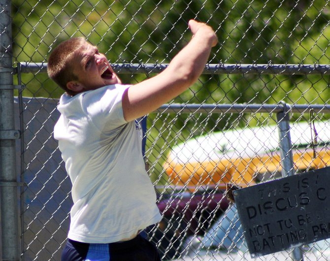 Moffat County junior Garrett Spears launches a throw in the Western Slope League boys discuss competition on Friday in Grand Junction. Spears threw a personal best of 134 feet, 9 inches and finished third in the competition.