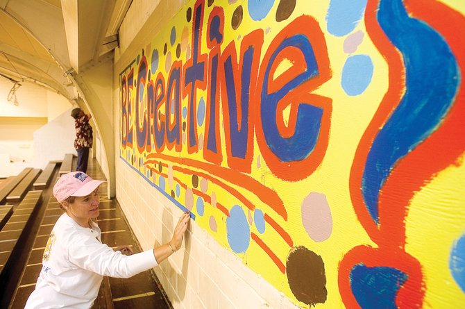 Jane Denning, of the Rotary Club of Steamboat Springs, prepares to paint a wall of the gym inside the Boys &amp; Girls Club of Steamboat Springs during the 2010 Routt County United Way Day of Caring. About 130 volunteers have signed up to work in the county for the Day of Caring, and Executive Director Kelly Stanford said there still are some volunteer opportunities.