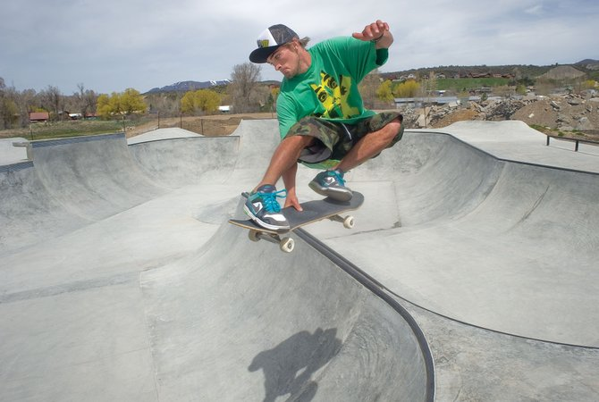 Mac Carmony launches out of the bowl Monday at Bear River Skatepark on the city's west side. The city is projecting about $2 million in excess sales tax revenues this year, and one possible use of the funds is $135,000 for a much-requested access road to the park. The allocations, though, will be subject to future City Council decisions.