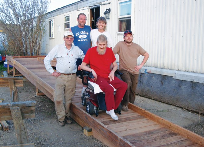 Volunteers stand with Hayden resident Randy Clark after they completed his wheelchair ramp at his home last weekend. Eleven volunteers worked on the project, which was associated with Concordia Lutheran Church and Routt County Habitat for Humanity.
