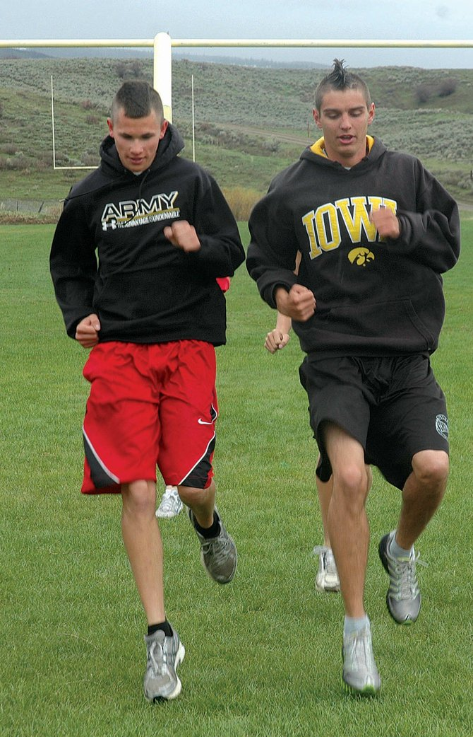 Nic Paxton, left, and David Strait warm up before one last workout on Wednesday. The two are part of a large contingent of Soroco High School athletes competing in Thursdays Colorado state track and field championships in Denver.