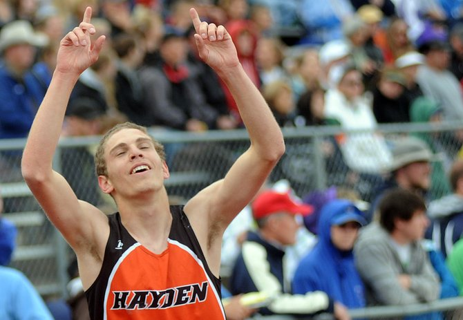Hayden senior Chris Zirkle throws his hands up soon after winning the 3,200-meter run on Friday at the state track meet in Lakewood. Zirkle won a thrilling duel with a late sprint, claiming his first state championship.