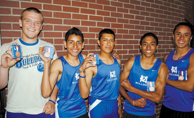 From left, Garrett Spears, Johnny Landa, Rene Molina, Alfredo Lebron and Miguel Molina pose with their medals Thursday at the 4A state track and field meet in Lakewood. Spears took sixth place in shot put while Landa, Rene, Lebron and Miguel took fifth place in the 4-by-800-meter relay.